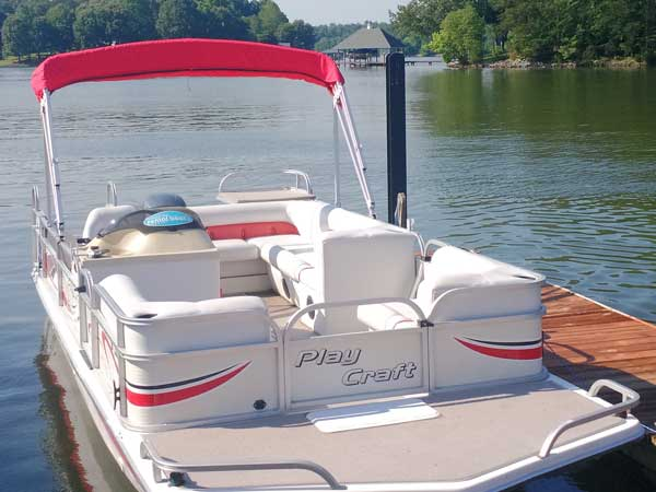 19 foot Pay Craft Deck Boat with 150hp Yamaha motor and bimini top seating 6 to 8 people