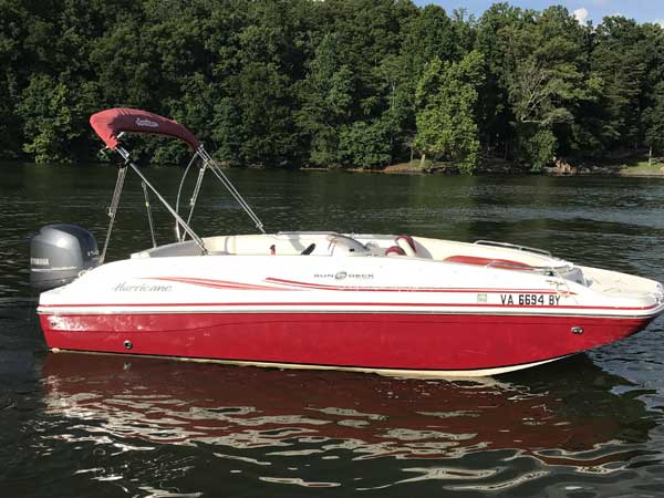19 foot Red Fun Deck boat with bimini top and 150hp Yamaha motor seating 6 to 8 people