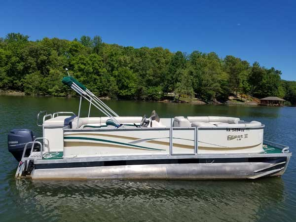 24 foot Crest Pontoon in white with green bimini top and a 90hp Yamaha 4-stroke motor