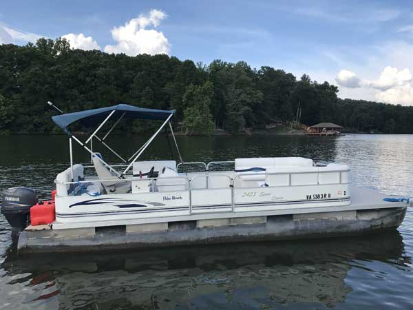 24 foot Crest Pontoon in white with green bimini top and a 50hp Yamaha 4-stroke motor