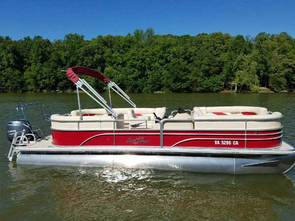 24 foot Sunchaser Pontoon 1 in red and white with bimini top and a 90hp Yamaha 4-stroke motor seating 10-12 people